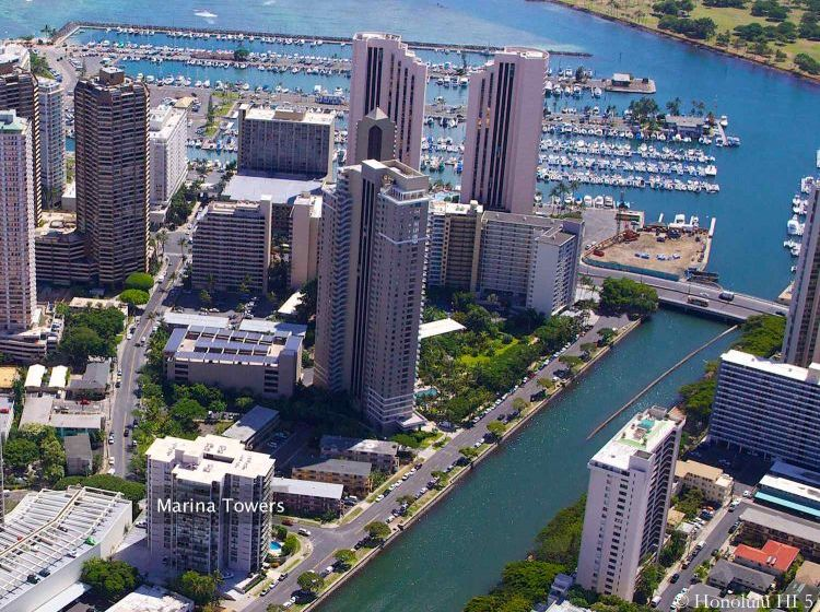 Marina Towers Condo in Waikiki Seen From the Air with Ocean and Harbor in Backdrop