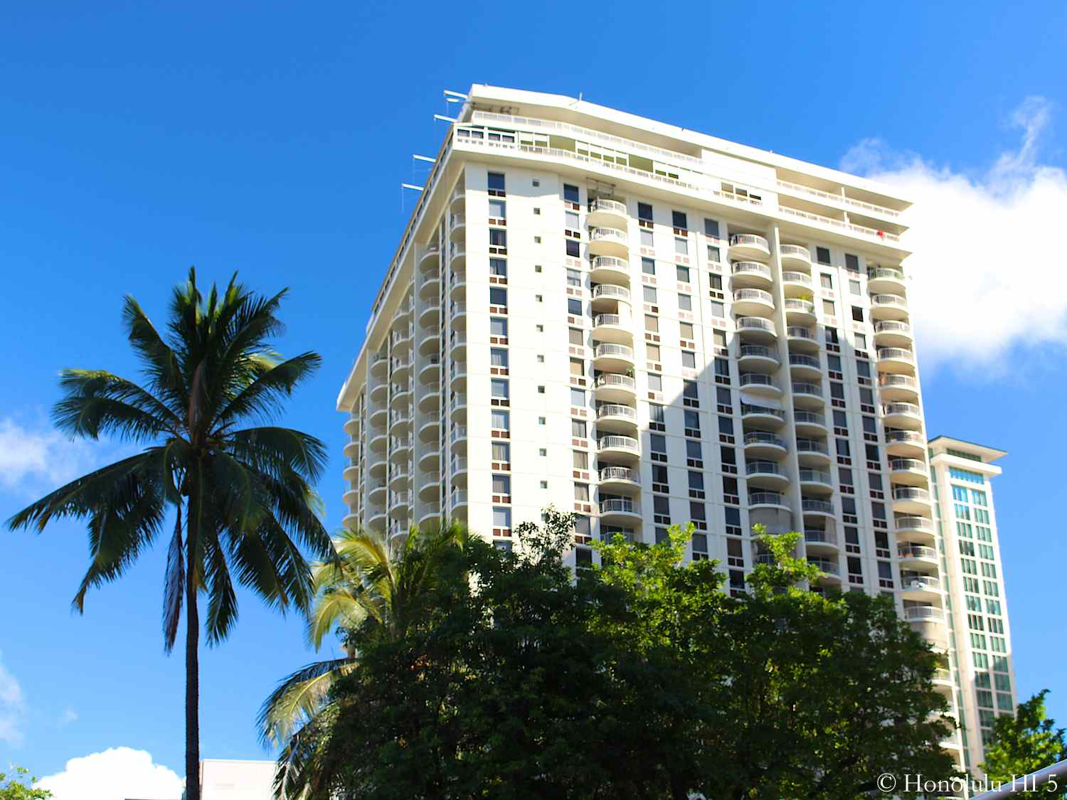 Top of 1717 Ala Wai Condo in Waikiki - a White Older Condo with Balconies