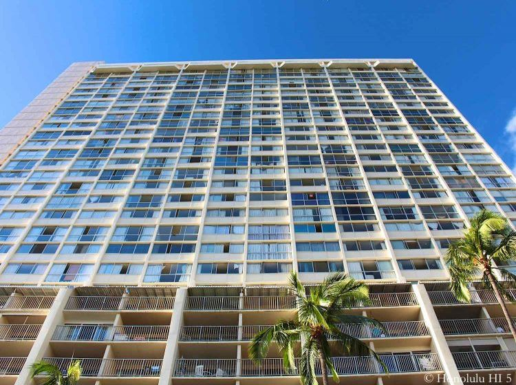Aloha Lani Condo Waikiki Seen From Bottom Up with Beautiful Blue Sky