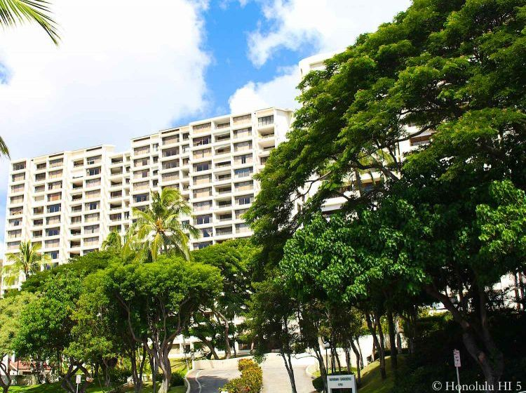 Heritage House Condos in Hawaii Kai - Very Wide High-rise in White with Lots of Green Trees in Front