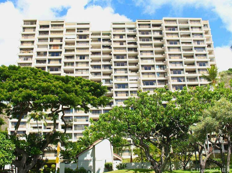 Heritage House Condos in Hawaii Kai. Older High-rise in White with Lots of Green In Front