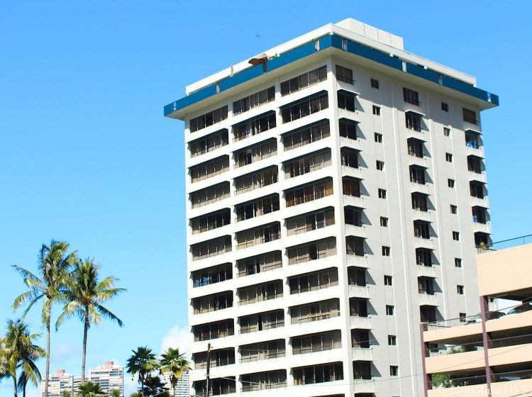 Middle to Higher Floors of Fairway Manor Condos in Waikiki. Square Shaped Old Building in White