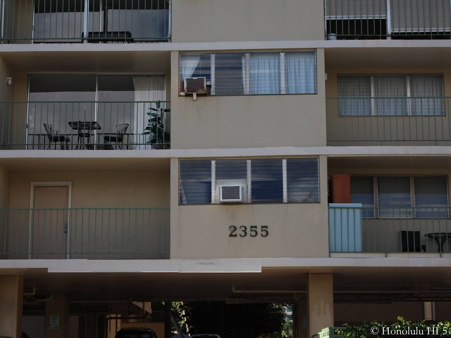 Lower Floor of Ala Wai Palms. Old White Building. Small Balconies.