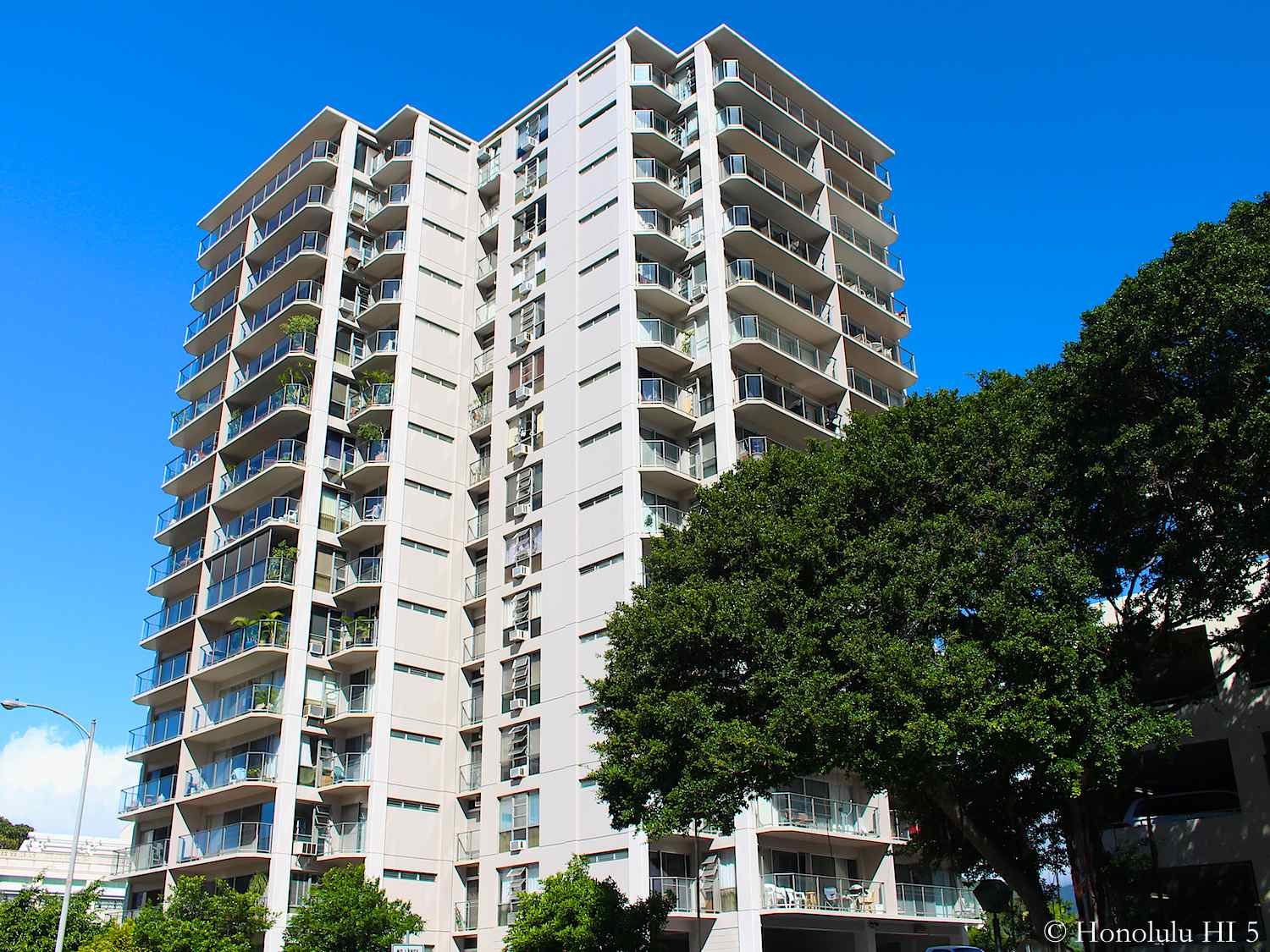 Marina Towers Condos in Waikiki - Older White Highrise With Each Unit Having a Lanai