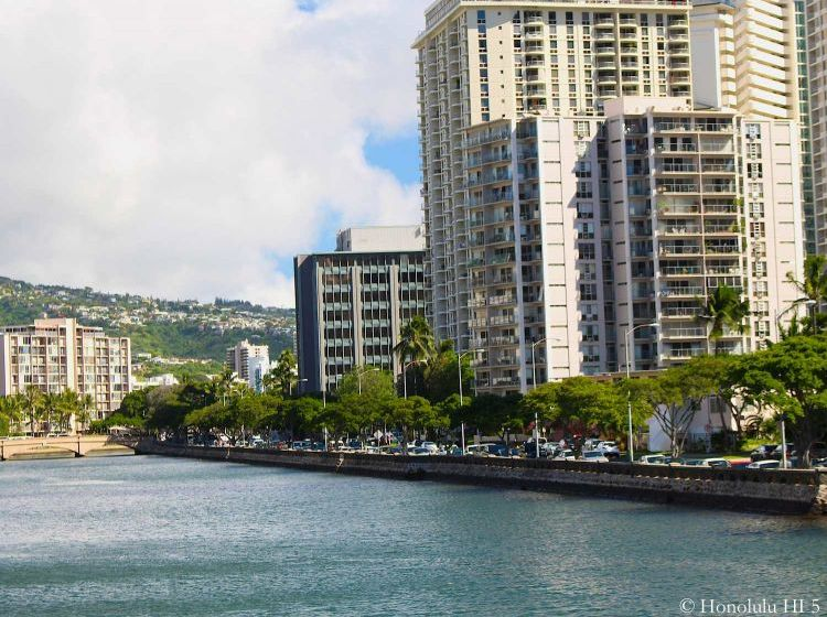 Marina Towers Waikiki Condo Seen From Ala Moana Boulevard with Ala Wai Canal in Front