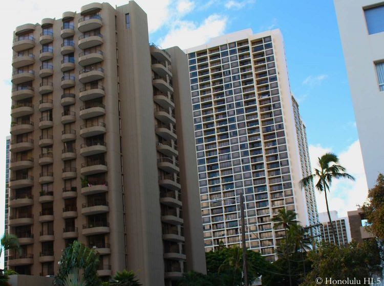 Leisure Heritage Condo Waikiki with Other Highrise in the Background.