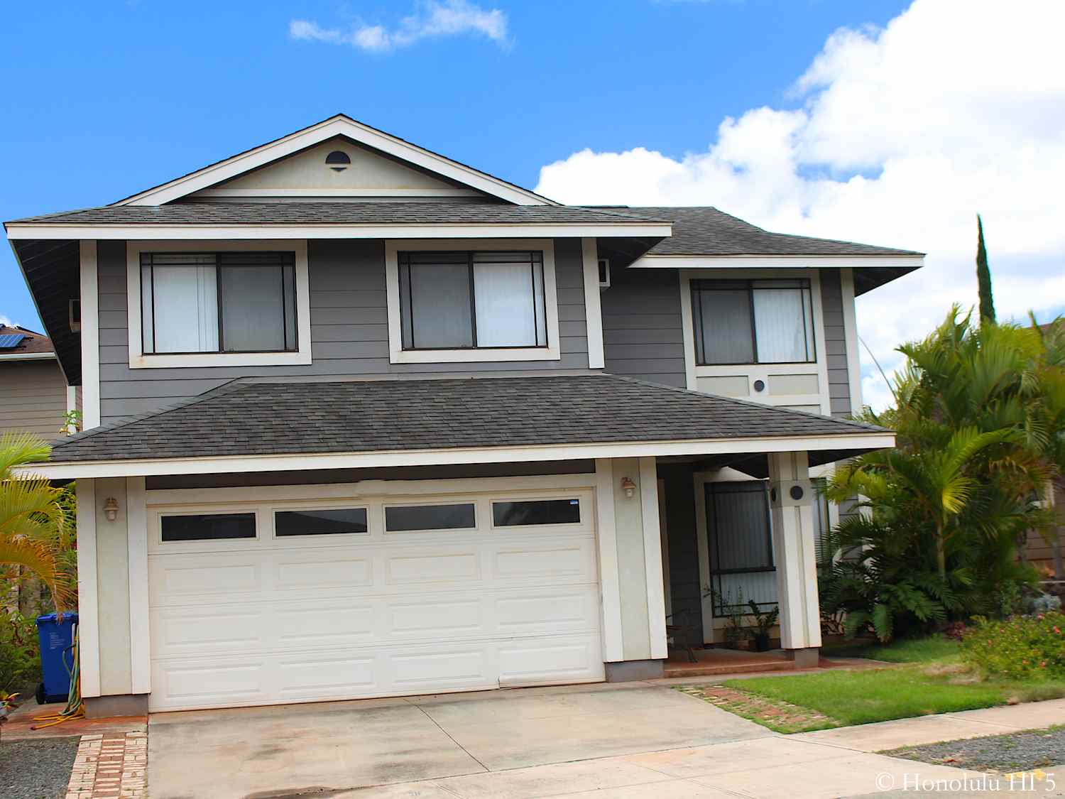 Two Story Grey Home in Royal Kunio