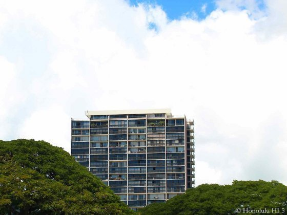 Kahala Towers Condo in Distant with Trees in Front