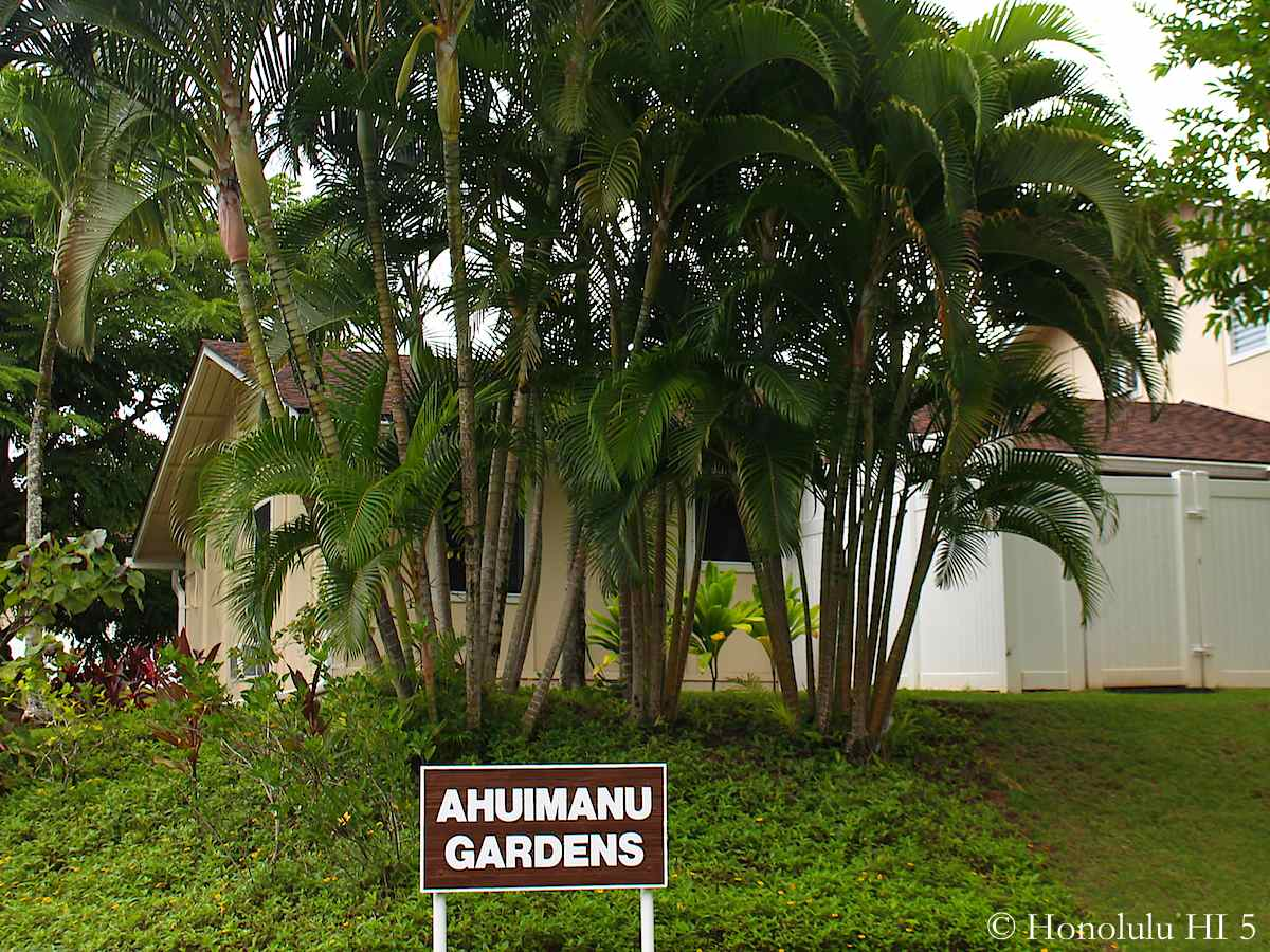 Entrance Sign to Ahuimanu Gardens and Townhomes Hidden Behind Lush Green