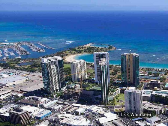 1133 Waimanu Condo Aerial Photo with Beach and Kakaako Super-block Condos Nearby