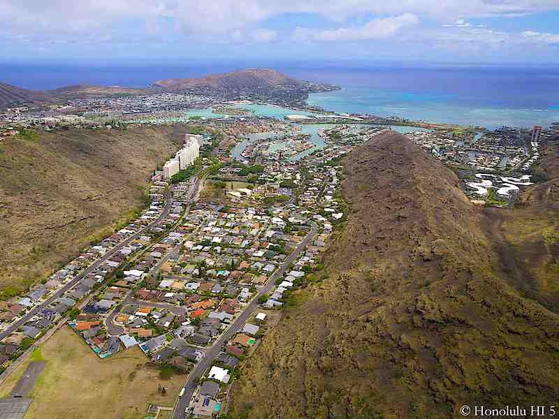 Condos in Hawaii Kai in Distance with Homes in Front - Aerial Photo