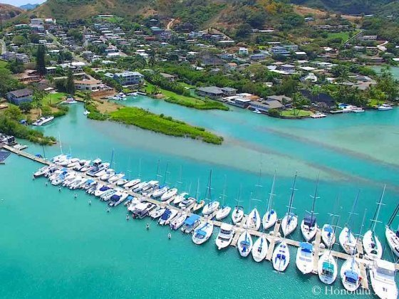 Kaneohe Homes On the Bay and Many Boats in Front - Aerial Photo