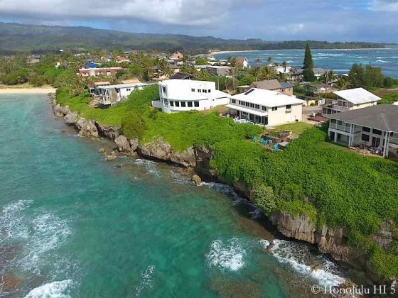 Laie Oceanfront Homes Hanging On Cliff - Aerial Photo
