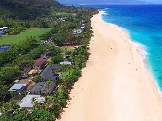 Sunset North Shore Oahu Homes Located On Wide White Pristine Sandy Beach - Aerial
