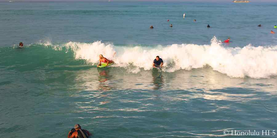 7.58am: Boogie boarders catching a Wave by Kuhio Beach in Waikiki