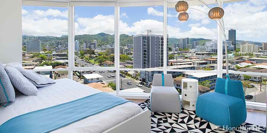 Bright guest bedroom in Moana Pacific #903