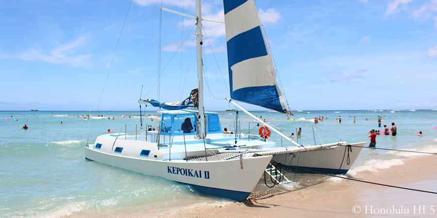 white-and-blue-catamaran-waikiki-beach