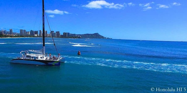 Boat Taking Off From Honolulu Harbor