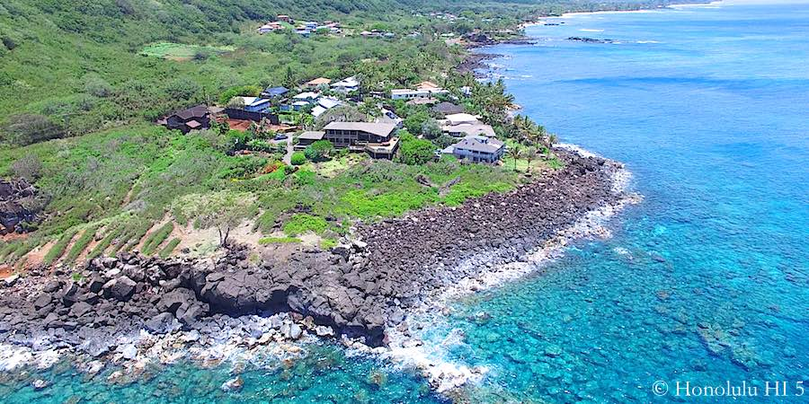 Waimea Homes Hanging on a Oceanfront Cliff - Aerial Photo