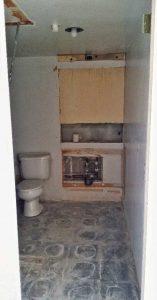 Week 2 - demolition - bath vanity, mirror and flooring removed