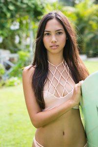 Bikini Model with Surfboard